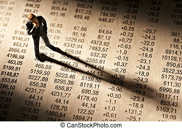 Broker stands on stock price chart, and casts a long shadow.