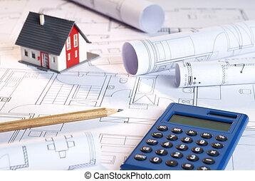Blueprints, house and calculator as a symbol for financing a...