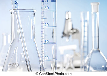 Close-up with Erlenmeyer flask, measuring jar and pipette...