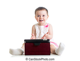 baby girl playing with a digital tablet, isolated on white background