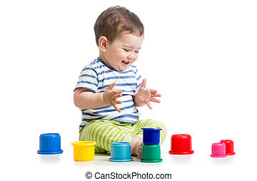 funny baby playing with colourful cup toys on floor,...