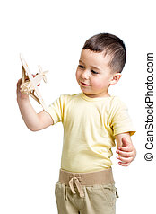 smiling child playing with wooden airplane toy