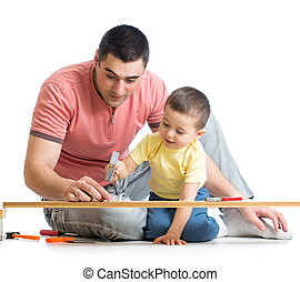 Kid and his dad working together