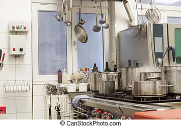 Neat interior of a commercial kitchen with wall mounted...