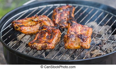 Barbecue Ribs on the grill. High quality video converted...