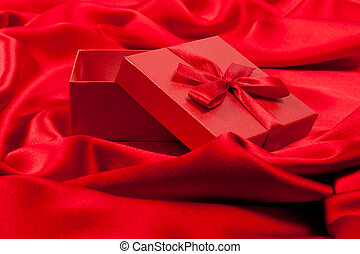 Open red fancy box on red silk - Open fancy box on luxurious...