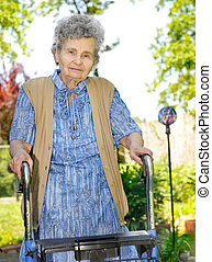 Senior woman outdoors - Senior woman walking with the help...
