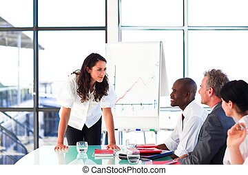 Confident businesswoman talking in a meeting