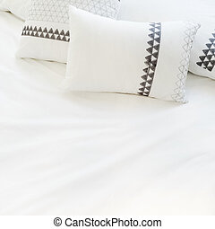 Elegant white bed linen with pillows - Bed with elegant...