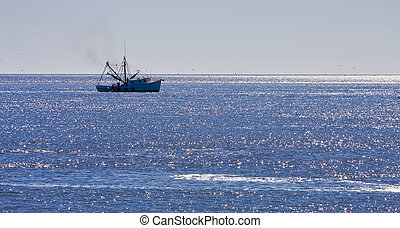 Shrimp Boat on Blue Seas - A shrimp boat off the coast in...