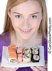Sushi - Beauty with sushi Beautiful woman holding a plate of...