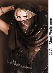 Belly Dancer - Blond Belly Dancer with long hair holding a...