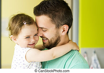 Father and daughter - Indoor portrait of young father...