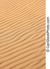Sand background - Waves of sand formed by wind Focus runs...