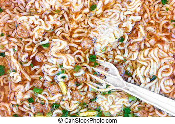 Instant noodles - Inundated by boiling water with spices...