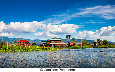 Ancient houses and their reflection in the water on the Inle...