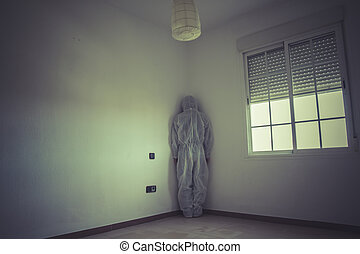Psychiatrist, nightmare man with red mask in empty room