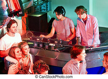 Dee Jay Booth - Two disc jockeys at work in the DJ booth at...