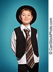 businesslike - Portrait of a cute smiling boy wearing suit...