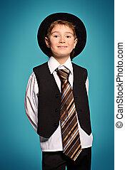 businesslike - Portrait of a cute smiling boy wearing suit...