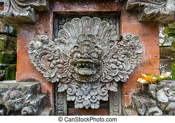 Ornate column in formal Balinese garden