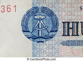 DDR banknote - DDR symbol on a 100 Mark banknote from East...