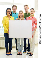 smiling students with white blank board at school -...