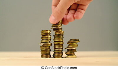 Hand stacking coins. Saving money, managing home budget....