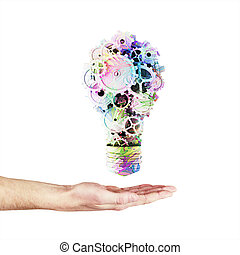 bulb with color gears - hand holding light bulb with color...