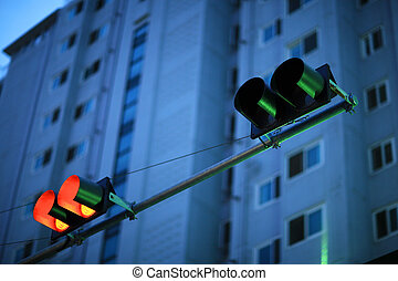 dusk scene with traffic light - dusk scene with red traffic...