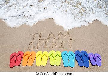 Sign quot;Team spiritquot; and color flip flops on sandy...
