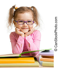 child girl in glasses reading book and smiling