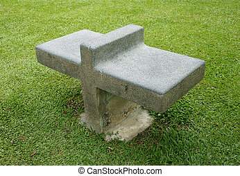 stone bench on grass land