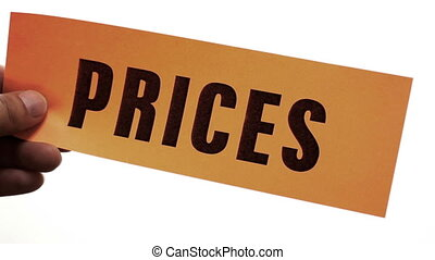 Cutting Prices Retail Sales - Cutting a bright orange piece...