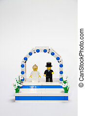 Lego Wedding - A Lego couple stood on under a Wedding arch