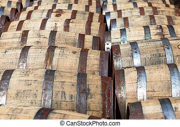 Bourbon barrels - Rows of oak bourbon barrels at a...