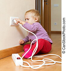 toddler playing with electricity at home - toddler playing...
