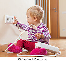 Toddler playing with electricity
