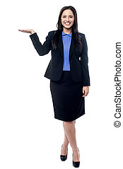 Business woman presenting something - Full length of...