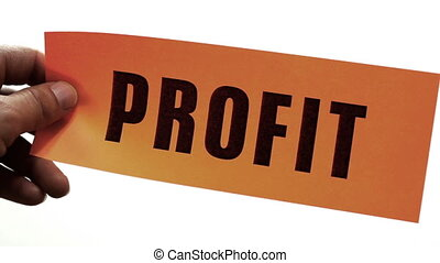 Profit Cuts Concept - Cutting a bright orange piece of paper...