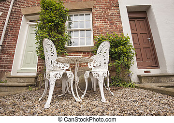Garden chairs and table on a patio
