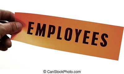 Cutting Employees Business Concept - Cutting a bright orange...