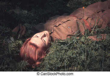 Young woman in Red Army form of 1943 year lying on the...