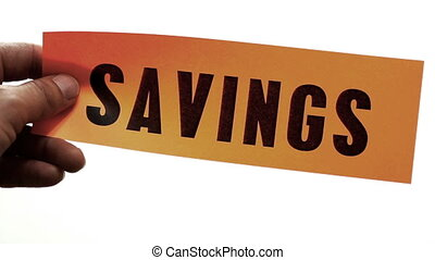Cutting Savings Concept - Cutting a bright orange piece of...