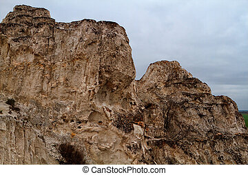 The rocky outcrop is located in the Upper Cretaceous of the...