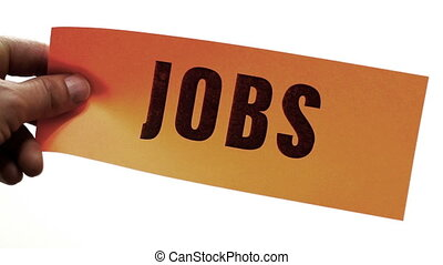 Cutting Jobs Business Concept - Cutting a bright orange...
