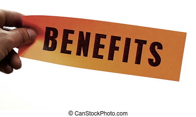 Cutting Benefits Concept - Cutting a bright orange piece of...