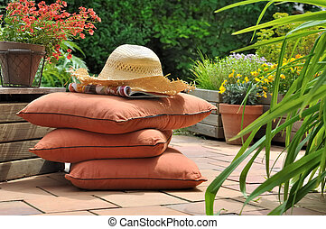 terrace for relaxing - cushions and straw hat on a terrace...
