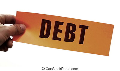 Cutting Debt Business Concept - Cutting a bright orange...