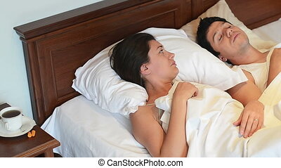 Marriage Secrets - A snorer man and a tired woman trying to...